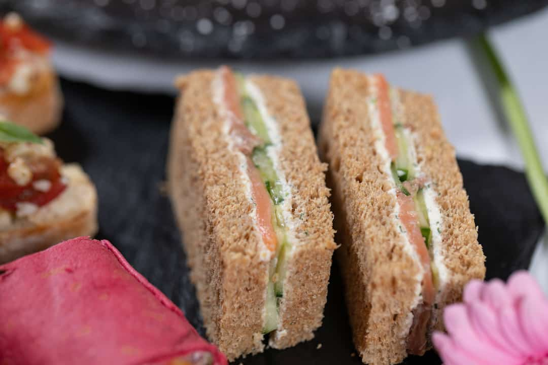 Smoked Salmon, cucumber, with dill, & lemon cream finger sandwich close up